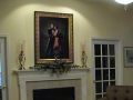 portrait-of-couple-above-fireplace